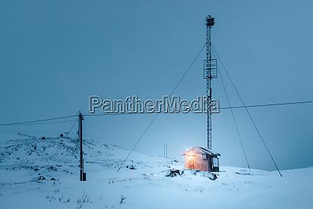 wooden hut in polar night kvaloya