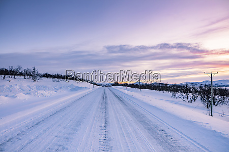frozen country road kilpisjaervi enontekioe finland