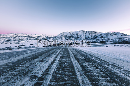 icy lane in winter lebesby norway