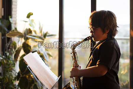 boy exercising to play the saxophone