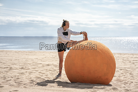 young woman during workout at beach