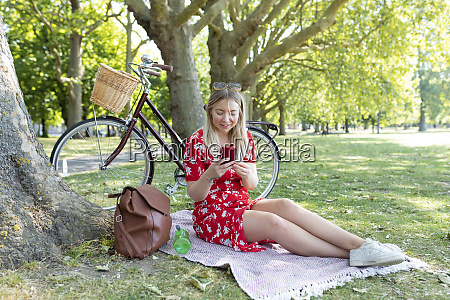 woman using smart phone while sitting