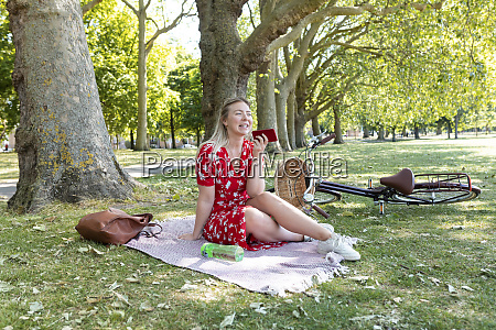 happy woman holding smart phone while