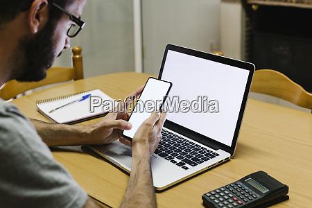 mid adult man using smart phone