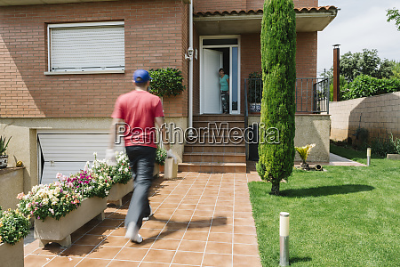 woman waiting for postal worker to
