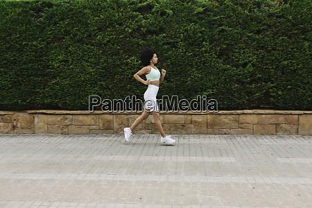 female jogger on steps