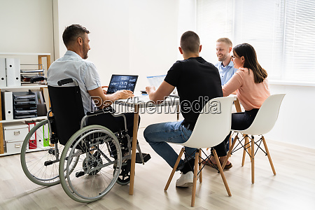 disabled people in wheelchair at workplace