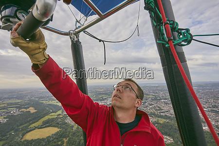 a balloon pilot adjusting the burning