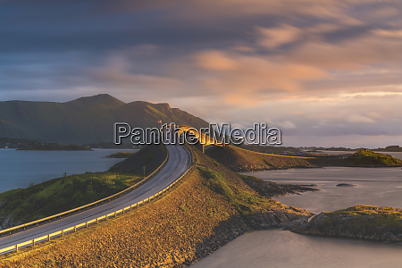 sunset over storseisundet bridge atlantic road