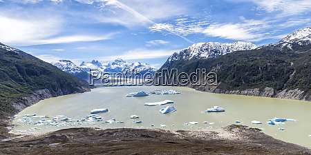 glacial lake with small icebergs floating