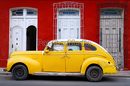 old classic yellow car cienfuegos cuba