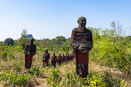 huge line of pilgrim statues in