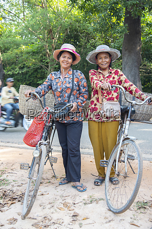 two local women with their bicycles
