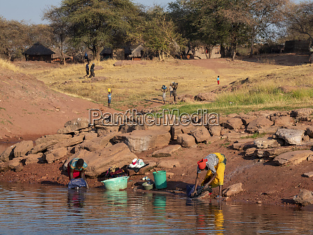 women doing laundry in the fishing