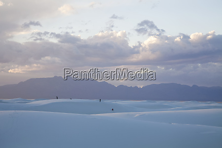 people playing on the dunes at