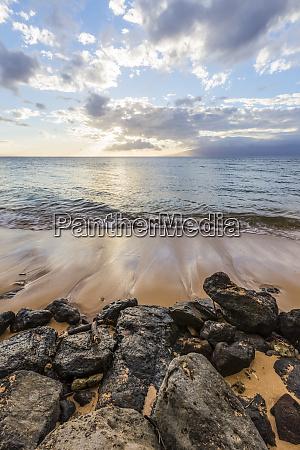 a calm sunset beach view from