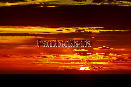 dramatic firey sunset over the sea