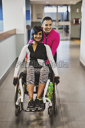 a paraplegic woman and her trainer