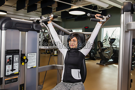a paraplegic woman working out using