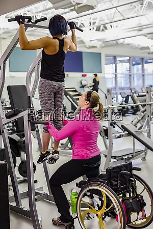 a physiotherapist assisting a paraplegic women