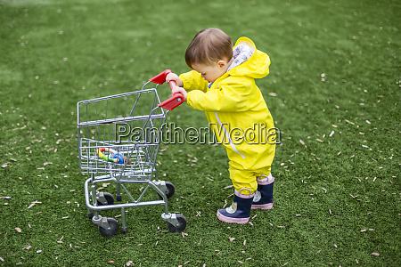 a girl toddler walks on grass