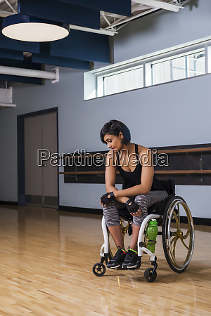 a paraplegic woman looking discouraged while