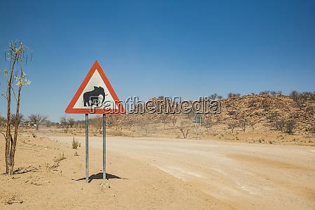 elephants warning sign on a roadside