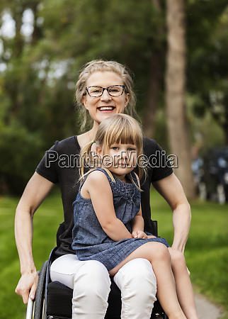a paraplegic mom holding her little