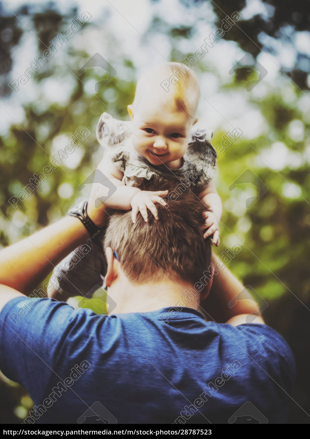 a, father, holding, his, baby, girl - 28787523