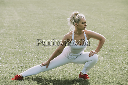 woman stretching her leg muscles on