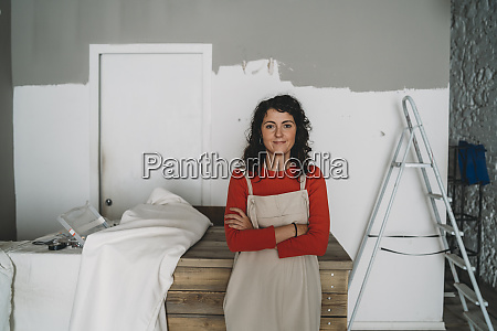 mid adult woman leaning against table