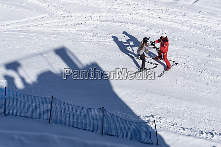 high angle view of two skiers
