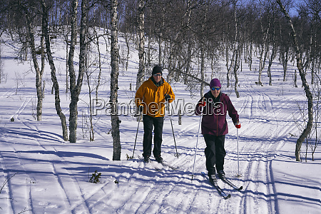 couple cross country skiing in vasterbottens