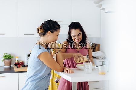 friends preparing lunch in kitchen