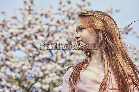 portrait of brunette girl standing outdoors
