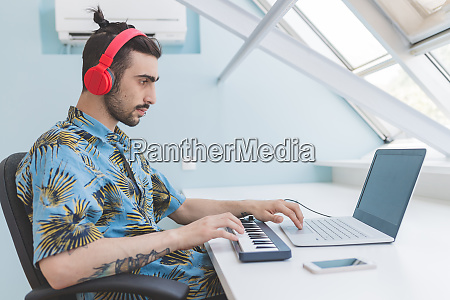 young bearded man sitting at a
