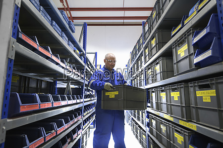 man holding a storage box in