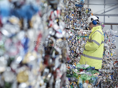 worker inspecting mixed waste in waste