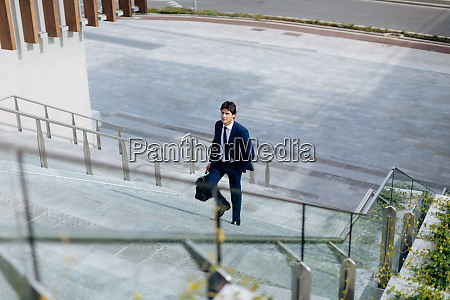 businessman walking up stairway