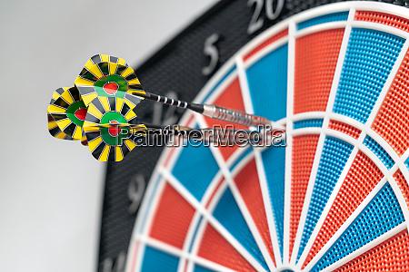 close up of a dart machine