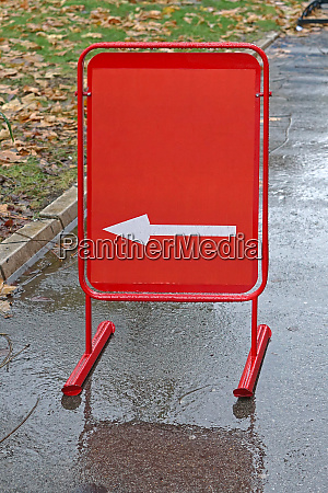 red direction board