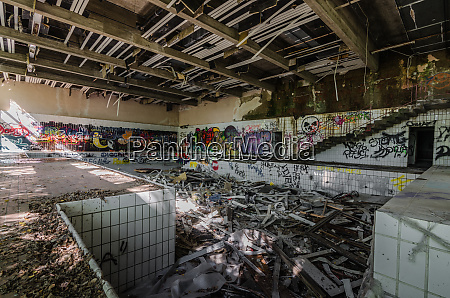 many graffiti in ruined indoor pool