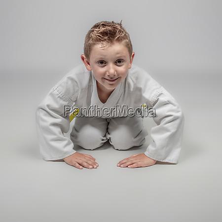 child with kimono in rei position