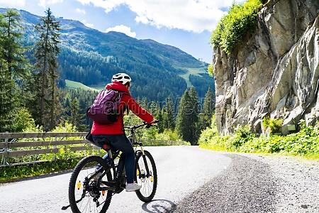 woman riding electric mountain bike