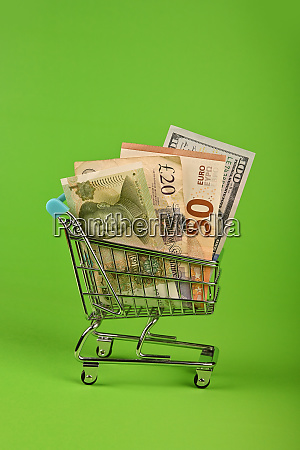 world paper currencies in shopping cart