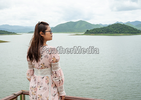 asian woman stand on the reservoir