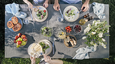 family dinner outdoors top view staycation