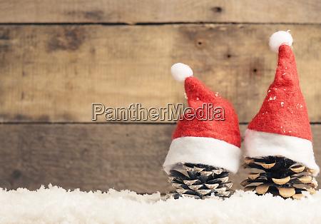 two pine cones with santa cap