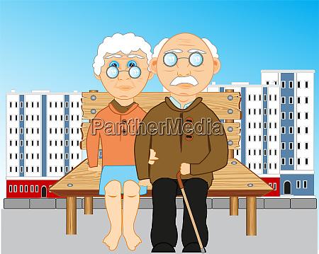 elderly people sit on bench in