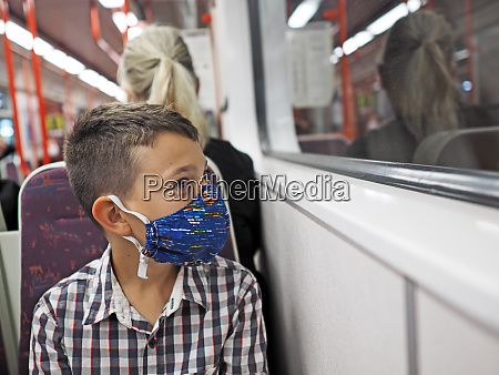 young boy with protective mask travels